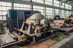 Interior of machinery of abandoned factory of synthetic rubber, rusty eqipment.  Royalty Free Stock Photography