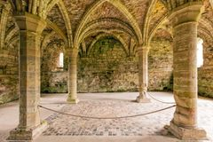 Chapter House, Buildwas Abbey, Shropshire, England. The interior of the magnificent vaulted Chapter House complete with medieval floor tiles at the famous royalty free stock photos