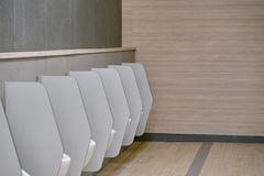 Interior of Male toilet with clean view. Pee potty with cover Royalty Free Stock Photo