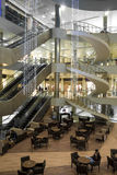 Interior of mall in Erbil,Iraq. Erbil, Iraq - March 7, 2016:Spiral stairs with coffee shop inside Mall in Erbil city Royalty Free Stock Photography
