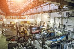 Interior of manufacturing metalworking factory warehouse with modern equipment tools and machines. View from above stock photography