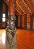 Interior of a Maori meeting house. Royalty Free Stock Image