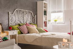 Interior with marital bed. Bright bedroom interior with marital bed Royalty Free Stock Photos