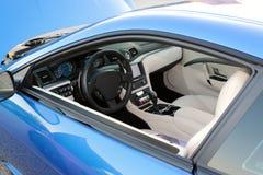 Interior of a Maserati Sports Car. Pristine tan leather interior of a Maserati high-end sports car Royalty Free Stock Images