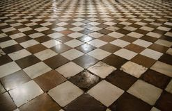 Interior of medieval cathedral with chess floor royalty free stock photography