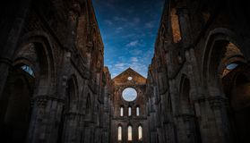 Detail of the interior of San Galgano Abbey, Tuscany. Interior of medieval San Galgano Abbey at the sunset, Tuscany, Italy Stock Image