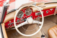 Interior Mercedess 190 SL, inside view, retro design car. Exhibition of vintage cars. Rally of old vintage vehicles anciens. Collectors unique cars. Red inside Stock Photos
