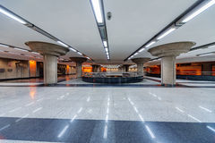 Interior of metro station. With marble hall and neon lights royalty free stock photography