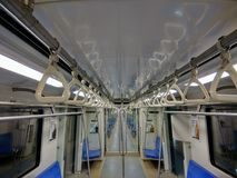 Interior of metro train with empty seats and abstract of handgrip inline Stock Image