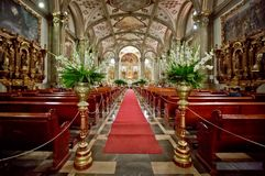 The interior of Mexican Church in Mexico city. The red carpet and interior of Mexican Church in Mexico city Royalty Free Stock Images