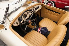 Interior MG 1600, inside view, retro design car. Exhibition of vintage cars. Rally of old vintage vehicles anciens. Collectors unique cars. Creamy-colored Royalty Free Stock Photo