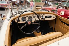 Interior MG 1600, inside view, retro design car. Exhibition of vintage cars. Rally of old vintage vehicles anciens. Collectors unique cars. Creamy-colored Stock Images