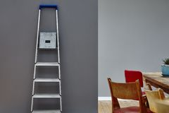 Interior mix dining table with ladder house moving party. Modern design Royalty Free Stock Photography