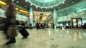 Interior of Modern Airport. Time lapse of travelers at the airport.  Shot with a Nikon d300s stock footage