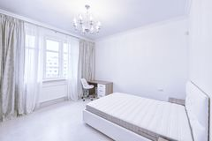 The interior of a modern apartment in white. Stock Photos