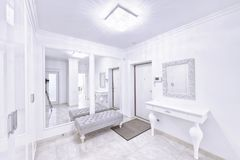 The interior of a modern apartment in white. Royalty Free Stock Image