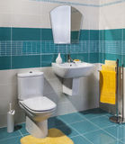 Interior of modern bathroom in blue with yellow accessories Royalty Free Stock Photo