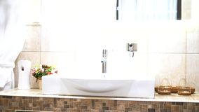 Interior of a modern bathroom. sink and mirror.  stock footage
