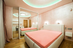 Interior of a modern bedroom with luxury ceiling lights Royalty Free Stock Photos