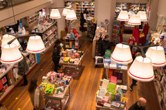 Interior of a modern bookshop with people from above browsing the collection. Stock Photo