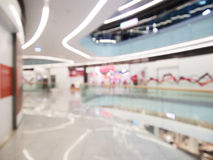 Interior of the modern building, blurred shopping mall background. Commercial or business center. Royalty Free Stock Image