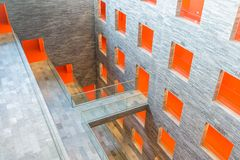 Interior modern building with several floors and orange painted passages Royalty Free Stock Photos