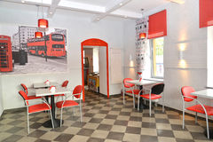 Interior of modern cafe in red and light tones Royalty Free Stock Image