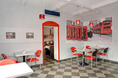 Interior of modern cafe in red and light tones Royalty Free Stock Photos