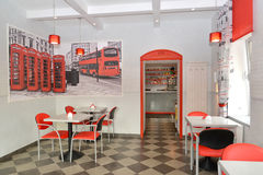 Interior of modern cafe in red and light tones Royalty Free Stock Images
