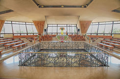 Interior of the modern church in Capernaum, Israel. CAPERNAUM, ISRAEL - AUGUST 30, 2015 : Interior of the modern church was built over the ruins of Peter`s house stock photo