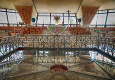 Interior of the modern church in Capernaum, Israel. CAPERNAUM, ISRAEL - AUGUST 30, 2015 : Interior of the modern church was built over the ruins of Peter`s house stock image