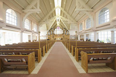 Interior Of Modern Church. Interior view of a modern church with empty pews Stock Photo