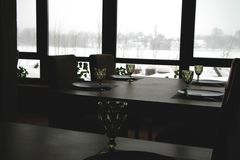 Interior of a modern country restaurant. View of the winter landscape royalty free stock image