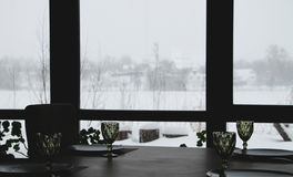Interior of a modern country restaurant. View of the winter landscape royalty free stock images