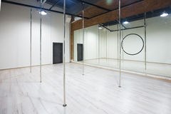 Interior of modern dancing studio for pole dance. Interior of modern dancing studio for pole dance royalty free stock image