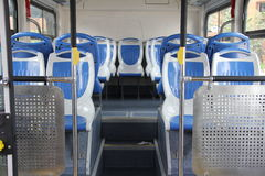 Interior of a modern empty city bus. Blue and grey seats for passengers in saloon of empty city bus with grey floor. chairs of new Chinese bus Stock Photography