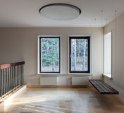 Interior of modern empty space with suspended bench and windows Royalty Free Stock Images