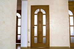 Interior of modern expensive house of apartment with wooden door. S Royalty Free Stock Images