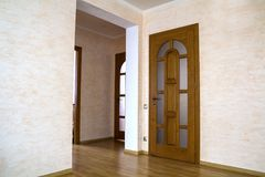 Interior of modern expensive house of apartment with wooden door. S Royalty Free Stock Photo