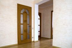 Interior of modern expensive house of apartment with wooden doors.  royalty free stock images