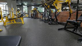 Interior Of Modern Fitness Gym - a lot of modern athletic trainer. Background, slider shot stock video