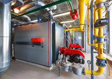 The interior of a modern gas boiler house with boilers, pumps, v Stock Photos