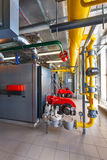 The interior of a modern gas boiler house with boilers, pumps, v Stock Images