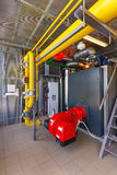 The interior of a modern gas boiler house with boilers, pumps, v Royalty Free Stock Photography