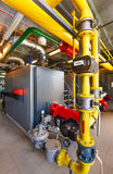 The interior of a modern gas boiler house with boilers, pumps, v Royalty Free Stock Photos