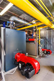 The interior of a modern gas boiler house with boilers, pumps, v Stock Photography
