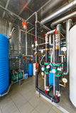 The interior of a modern gas boiler house with pumps, valves, a Royalty Free Stock Images