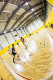 Interior of a modern  gymnasium with young people Royalty Free Stock Image