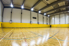 Interior of a modern gymnasium with young people. Interior of a modern multifunctional gymnasium with young people royalty free stock images