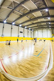 Interior of a modern  gymnasium with young people Royalty Free Stock Photos